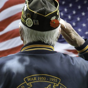 Veteran's Saluting  in Front of US Flag